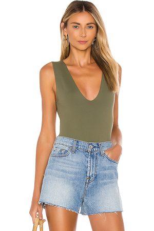 Free People Keep It Sleek Bodysuit in Olive. - size L (also in M, XS, S)