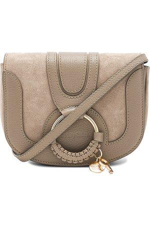 See by Chloé Hana Mini Crossbody Bag in Neutral.