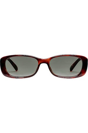 Le Specs Unreal! in Brown.
