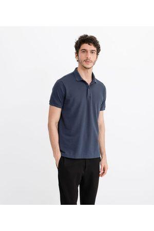 Request Camisa Polo em Tricô Listrada | | | G