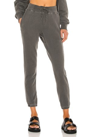 NSF Sayde Slouchy Slim Sweatpant in Black. - size L (also in M, S, XS)