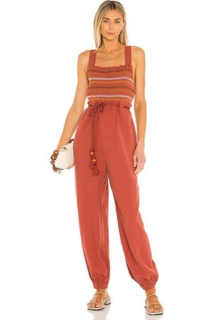 Free People Sienna Smocked Jumpsuit in Brick. - size L (also in M, S, XS)