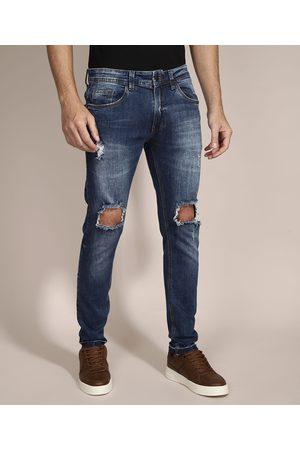 Clockhouse Calça Skinny Jeans Destroyed com Bolsos Escuro