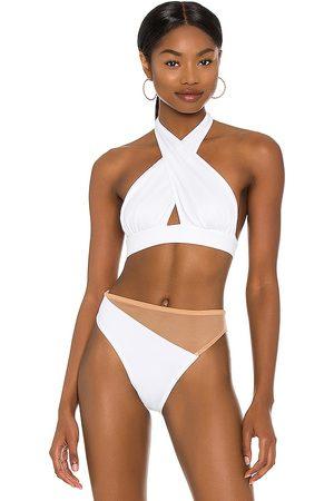 Norma Kamali X REVOLVE Cross Halter Bikini Top in . - size L (also in M, S, XS)