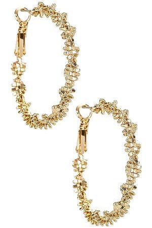 Amber Sceats Textured Hoop Earrings in Metallic .