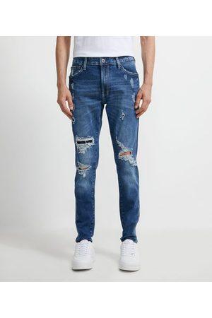 Blue Steel Homem Calça Skinny - Calça Super Skinny em Jeans com Puídos | | | 42