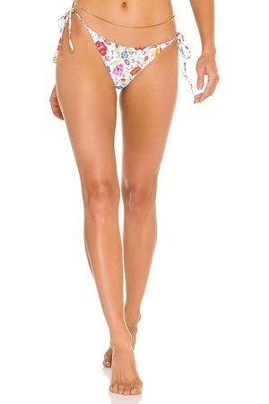 Luli Fama Wavy Ruched Back Tie Side Bikini Bottom in White. - size L (also in M, S, XS)
