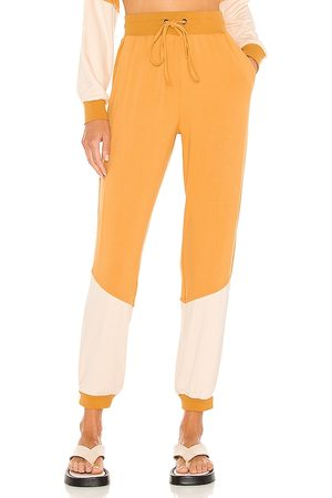 KENDALL + KYLIE Colorblock Jogger in Mustard. - size L (also in M, S, XS)