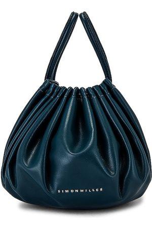 SIMON MILLER Vegan Leather Scrunch Bag in Blue.